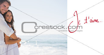 Composite image of smiling couple hugging and looking
