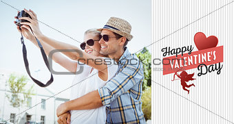 Composite image of stylish young couple taking a selfie