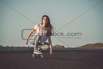 Skater girl making dowhill