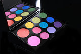 Colorful Palette of Various Eyeshadows on Black Background