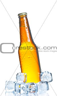 tilted bottle of fresh beer with ice and drops, concept of fresh beer on summer