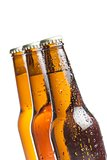 three bottles of fresh beer with drops, isolated