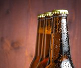 three bottles of fresh beer with drops