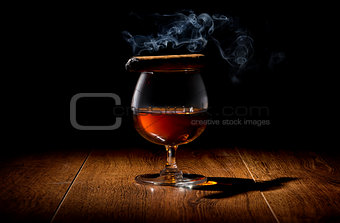 Cigar on wineglass
