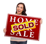 Mixed Race Female with Sold Home For Sale Sign