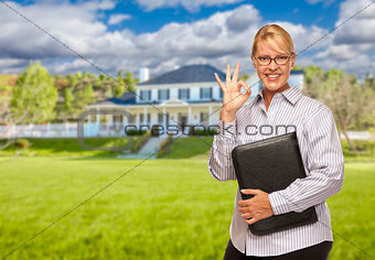 Attractive Businesswoman In Front of Nice Residential Home