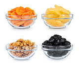 collection of dried fruit in a glass bowl on a white background