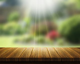 Wooden table and abstract blur landscape