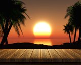 Wooden table and tropical sunset