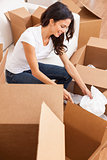 Single Woman Unpacking Packing Boxes Moving House