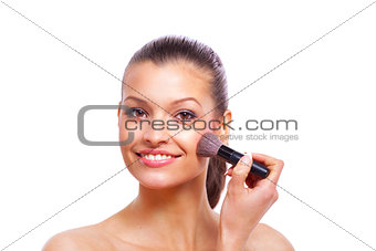 Beautiful young woman applying cosmetic