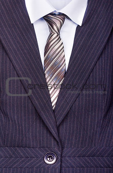 Close up of businessman wearing a tie, shirt, and suit