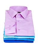 stack of colored shirt on a white background