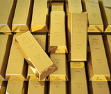 Macro view of stacks of gold bars.