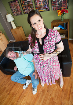 Pregnant Woman Grabbing Man's Collar