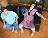 Exhaused Expecting Woman and Husband