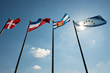 Blue sky with four flags