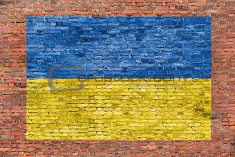 Flag of Ukraine painted over brick wall