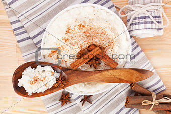 Rice pudding with wooden spoon.