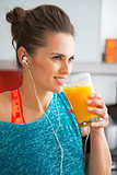 Happy fitness young woman drinking pumpkin smoothie