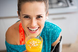 Portrait of happy fitness young woman with pumpkin smoothie