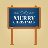 Merry Christmas Greeting on Green Chalkboard
