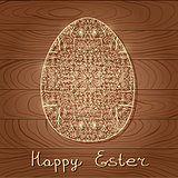 Decorated Easter Egg on Wood Background