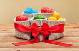Colorful easter eggs in burlap bags - festive arrangement