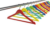 Colorful clothes hangers isolated on white background