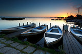 sunrise on lake harbor with boats