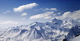 Snowy winter mountains in sun day. Panoramic view.