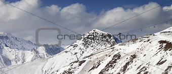 Off-piste slope and chair-lift in little snow year. Panoramic vi