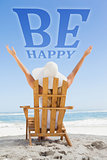 Composite image of woman sitting in deck chair at the beach with arms up
