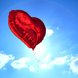 Composite image of red heart balloon