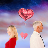 Composite image of couple not talking with broken heart between them