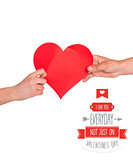 Composite image of hands holding red heart