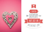 Composite image of wicker heart ornament with pink paper cut out