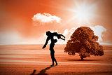 Composite image of ballet partners dancing gracefully together