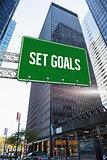 Set goals against skyscraper in city