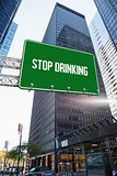 Stop drinking against skyscraper in city