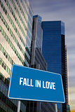 Fall in love against low angle view of skyscrapers