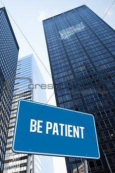 Be patient against low angle view of skyscrapers