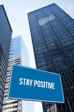 Stay positive against low angle view of skyscrapers