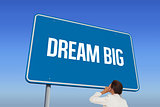 Dream big against bright blue sky