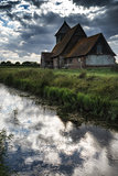 Ancient Medieval church landscape against evening Summer sky