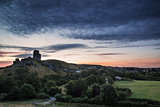 Beautiful Summer sunrise over landscape of medieval castle ruins