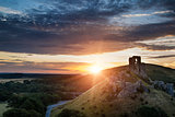 Castle ruins landscape at sunrise with inspirational sunburst be