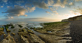 Beautiful landscape panorama sunset over rocky coastline