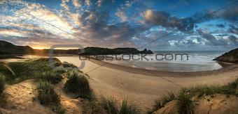 Beautiful Summer sunrise landscape over yellow sandy beach