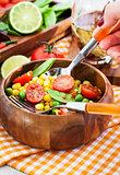 Fresh salad with corn, peas, tomato and chilli